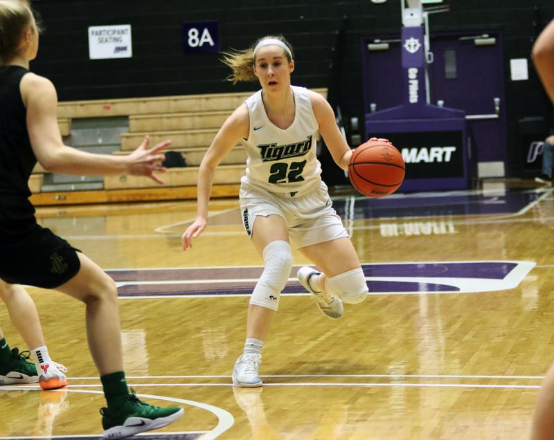 PMG PHOTO: DAN BROOD - Tigard High School junior Delaney Leavitt controls the ball in the front court during the Tigers' win over Jesuit on Friday.
