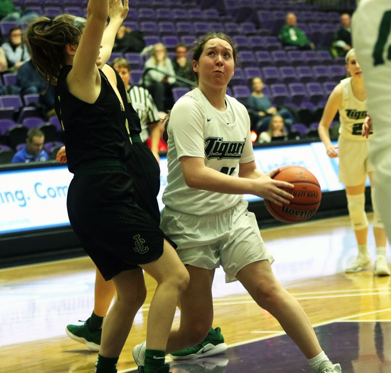 PMG PHOTO: DAN BROOD - Tigard senior guard Paige LaFountain looks to go up to the basket during the Tigers' 45-43 win over Jesuit on Friday.