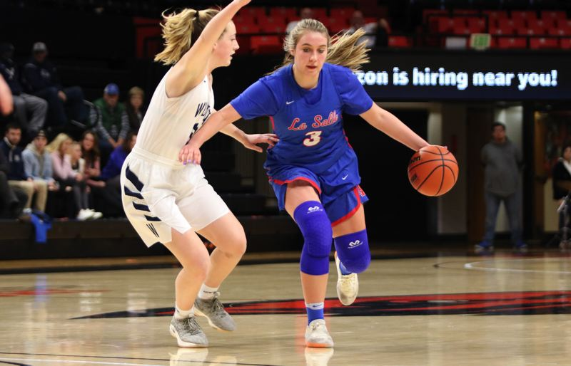 PMG PHOTO: JIM BESEDA - La Salle Prep's Addi Wedin led all scorers with 23 points, leading the Falcons to a 79-63 victory over top-ranked Wilsonville in Friday's OSAA Class 5A girls' basketball semifinal at Gill Coliseum.