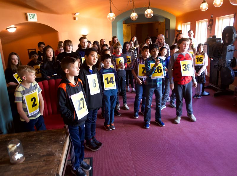 PMG PHOTO: JAIME VALDEZ - The 43 contestants in the 16th-annual Regional Spelling Bee, sponsored by Pamplin Media Group, buzz about in the Hollywood Theatre before the contest began on Saturday, March 9.