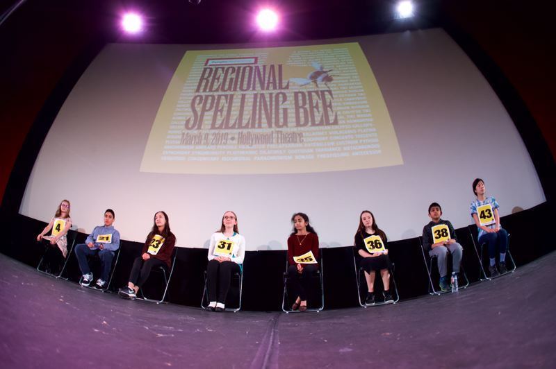 PMG PHOTO: JAIME VALDEZ - The final eight contestans in the 2019 Regional Spelling Bee, sponsored by Pamplin Media Group, await the next round of words on Saturday, March 9 inside the Hollywood Theatre.