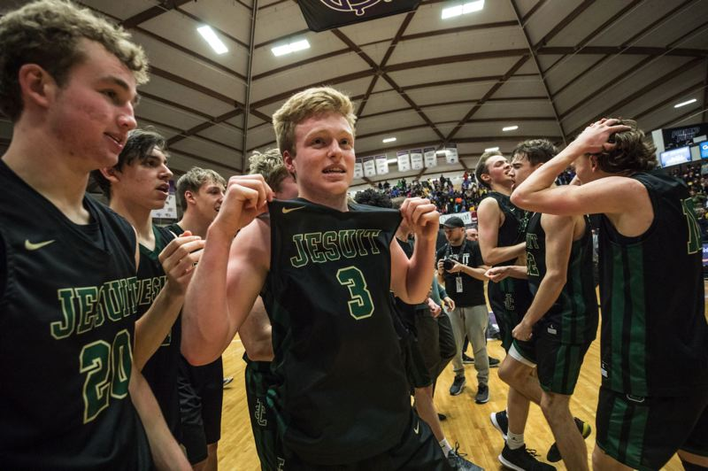 PAMPLIN MEDIA GROUP: JONATHAN HOUSE - Jesuit senior guard Aiden Williams and the Crusaders celebrate after knocking off Jefferson 71-66 for the Class 6A championship on Saturday at Chiles Center.