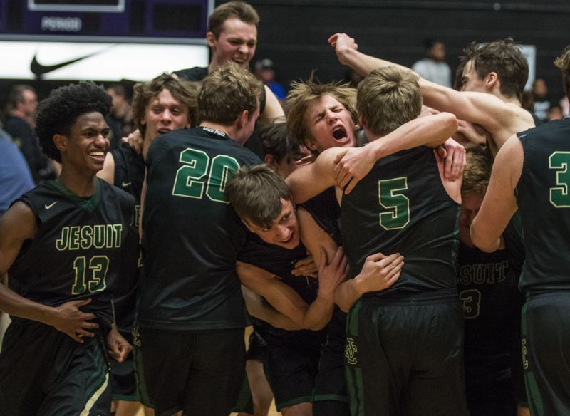 TIMES PHOTO: JON HOUSE - The Jesuit boys basketball team beat Jefferson in the Class 6A state championship game on Saturday to win its seventh title in program history.