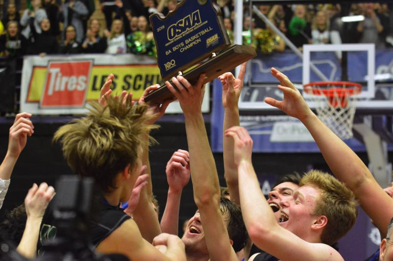 TIMES PHOTO: MATT SINGLEDECKER - The Jesuit boys basketball team beat Jefferson in the Class 6A state championship game on Saturday to win its seventh title in program history.
