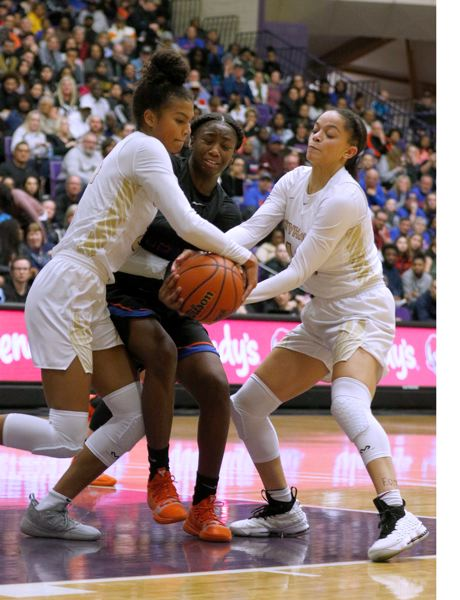 TIMES PHOTO: JON HOUSE - Southridge wings Kilyn Dawkins and Kyla Vinson smother a Benson ball handler in the Class 6A state title.