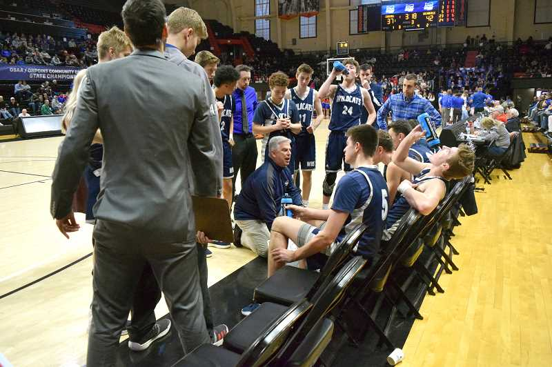 SPOKESMAN PHOTO: TANNER RUSS - Wilsonville coach Chris Roche talks strategy during a timeout against Churchill.