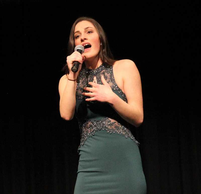 PMG PHOTO: JUSTIN MUCH - Miss Gervais Abigail Saalfeld sings Adele's 'When We Were Young' during the 2019 Mr. and Miss Gervais Pageant, Saturday, March 9.