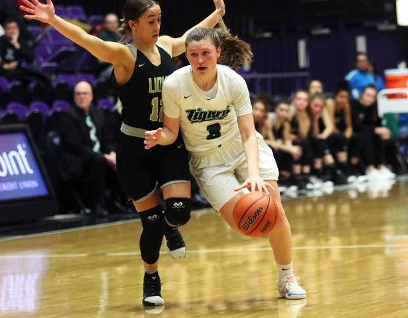 PMG PHOTO: DAN BROOD - Tigard High School senior Campbell Gray (right) tries to drive past West Linn sophomore Payton Shelstad during Saturday's fourth-place game at the Class 6A state tournament.