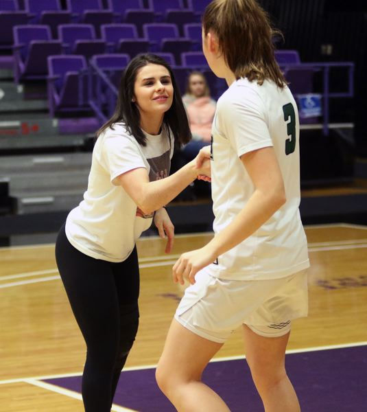 PMG PHOTO: DAN BROOD - Tigard junior Kennedy Brown (left), who was injured during the Tigers' win over Jesuit on Friday, shakes hands with senior Campbell Gray prior to Saturday's tourney game with West Linn.