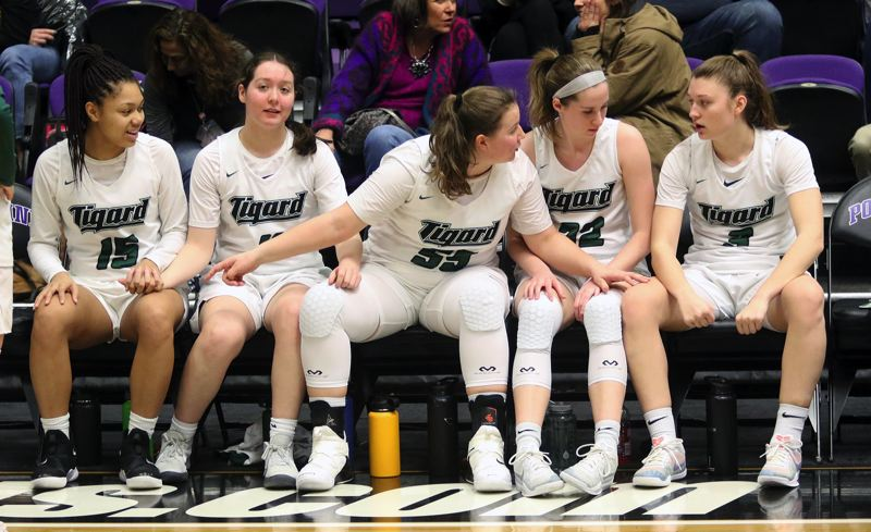 PMG PHOTO: DAN BROOD - Tigard starters (from left) Ajae Holdman, Paige LaFountain, Dani Lyons, Delaney Leavitt and Campbell Gray get ready for the start of Saturday's fourth-place game at the Class 6A state tournament.