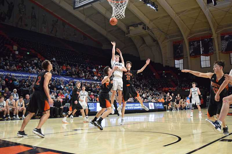 SPOKESMAN PHOTO: TANNER RUSS - Junior Gabe Reichle launches a mid range jumper against Silverton.