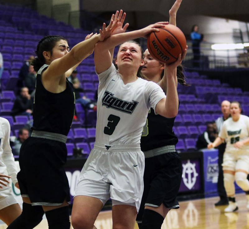 PMG PHOTO: DAN BROOD - Tigard High School senior Campbell Gray (3) battles a West Linn double team to put up a shot during the Tigers' fourth-place victory on Saturday.
