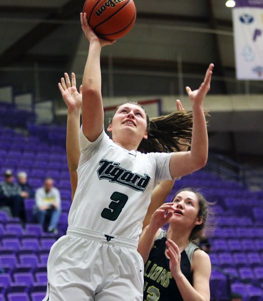 PMG PHOTO: DAN BROOD - Tigard High School senior Campbell Gray goes up to the basket for two of her game-high 24 points in the Tigers' state tournament win over West Linn.