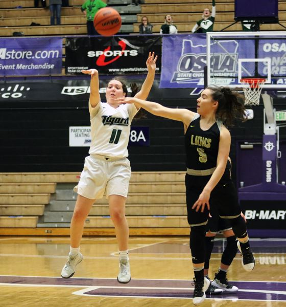 PMG PHOTO: DAN BROOD - Tigard High School senior Paige LaFountain (11) puts up a long-distance shot as the first quarter ends during Saturday's state tournament game with West Linn.