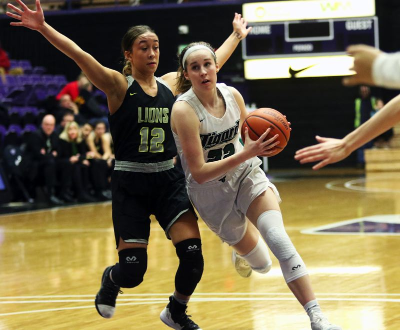 PMG PHOTO: DAN BROOD - Tigard High School junior Delaney Leavitt (right) drives past West Linn sophomore Payton Shelstad during Saturday's Class 6A state tournament fourth-place game.