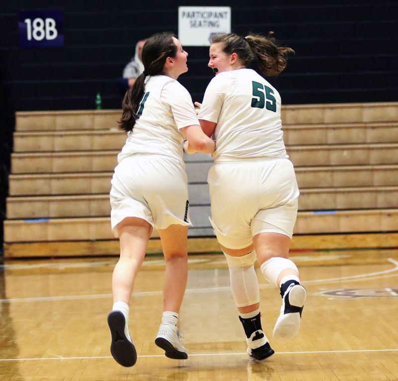 PMG PHOTO: DAN BROOD - Tigard High School seniors Paige LaFountain (left) and Dani Lyons share a laugh as they run back down court following one of Lyons' five 3-pointers in the win over West Linn.