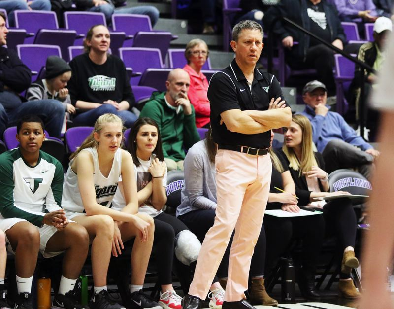 PMG PHOTO: DAN BROOD - Tigard High School head coach Steve Naylor watches the action during the Tigers' fourth-place win over West Linn on Saturday.