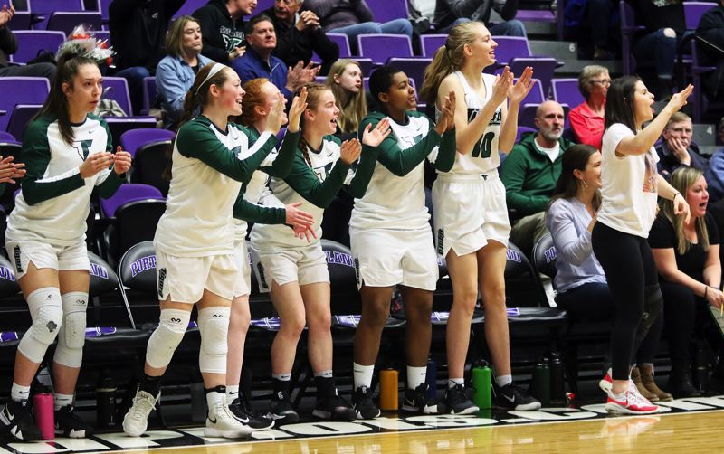 PMG PHOTO: DAN BROOD - Tigard players cheer on their teammates during the Tigers' 44-34 win over West Linn in Saturday's Class 6A state tournament fourth-place game.