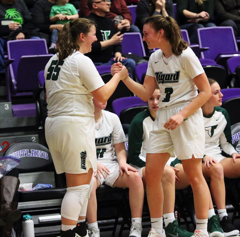 PMG PHOTO: DAN BROOD - Tigard High School seniors Dani Lyons (left) and Campbell Gray smile and celebrate near the end of the Tigers' fourth-place win over West Linn.