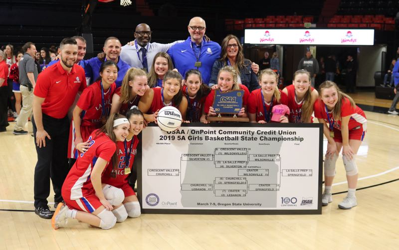 PMG PHOTO: JIM BESEDA - La Salle Prep defeated Springfield 55-48 in Saturday's OSAA Class 5A girls' basketball champiosnhips final at Gill Coliseum in Corvallis -- the Falcons' fourth state title in seven seasons.