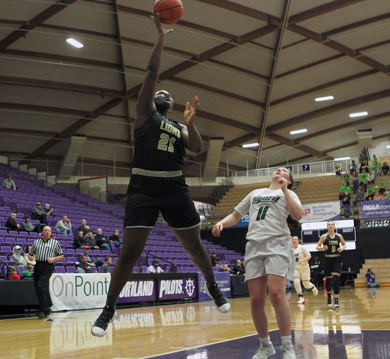 PMG PHOTO: MILES VANCE - West Linn sophomore Aaronette Vonleh goes up for a shot during her teams 54-44 loss to Tigard in the fourth-place game of the Class 6A state tournament at the Chiles Center on Saturday.