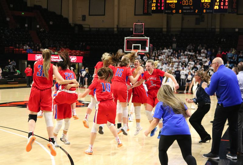 PMG PHOTO: JIM BESEDA - La Salle Prep players erupt in celebration as the final horn sounds in the Falcons' 55-48 victory over Springfield in Saturday's OSAA Class 5A girls' basketball championship final in Corvallis.