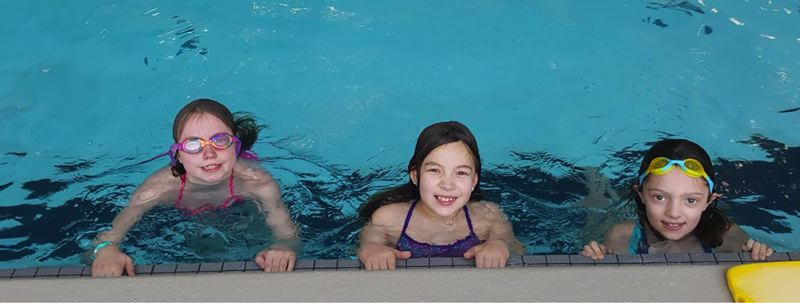 Gaffney Lane students Emily Welsh, Lilly Blattner and Gabby Clinard took their swimming skills to the next level during a week of lessons organized by their school.