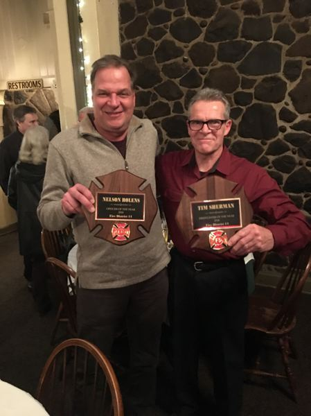 COURTESY PHOTO - Nelson Rolens and Tim Sherman pose with their awards at Multmonah Falls Lodge on Saturday, Feb. 9.