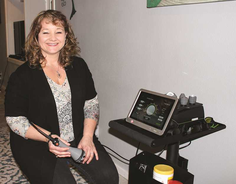 HOLLY SCHOLZ/CENTRAL OREGONIAN  - Massage therapist Chera Sowers purchased a Lightforce FXi, 15-watt, class 4 continuous wave laser last fall and offers deep tissue laser therapy treatments for acute and chronic conditions.