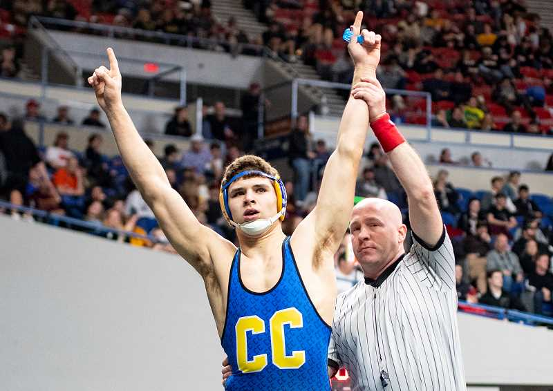 LON AUSTIN/CENTRAL OREGONIAN - Kyle Knudtson, shown raising his hands in victory at the state tournament, is one of three returning CCHS state champions. Knudtson won his state title at 182 pounds. Other team champions include Hunter Mode, 126, and Zach Mauras, 132.
