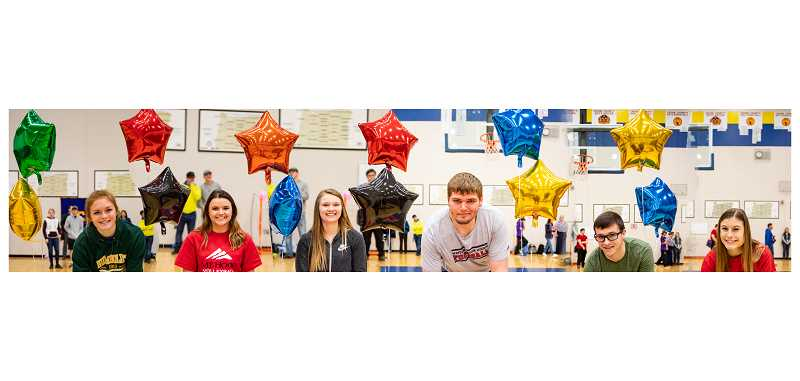 LON AUSTIN/CENTRAL OREGONIAN - Six Crook County High School athletes signed letters of intent during a school sports assembly Friday morning. Those athletes are (left to right) Grace Kasberger, Humboldt State for track and field, Mekynzie Wells, Mount Hood Community College for volleyball, Caitlyn Elliott, Treasure Valley Community College for softball, Caleb Parrott, Western Oregon for football, Noah Chaney, Eastern Oregon, for track and field, and Faith Wagner, Eastern Oregon for track and field.