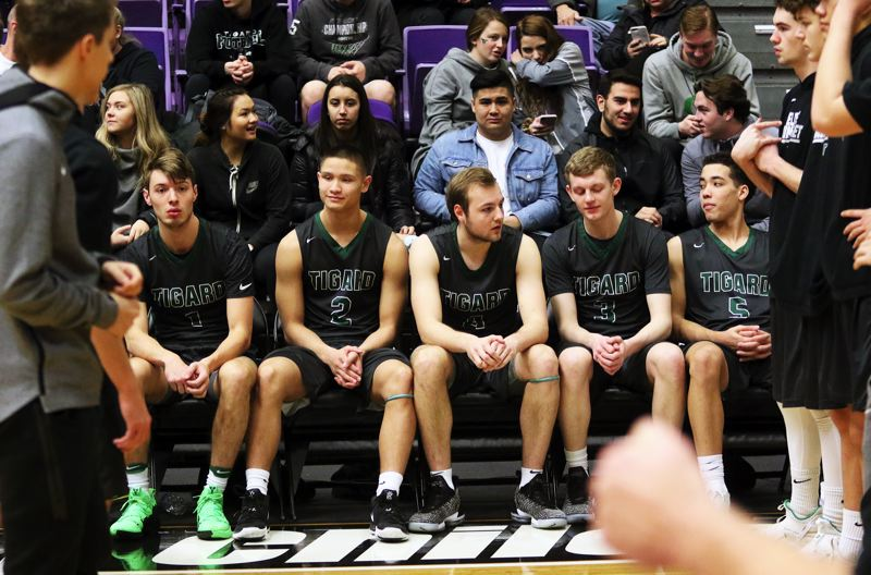 PMG PHOTO: DAN BROOD - Tigard starters (from left) Diego Lopez, Jazz Ross, Stevie Schlabach, Jake Bullard and Drew Carter get ready for the Tigers' tournament game with Grant.