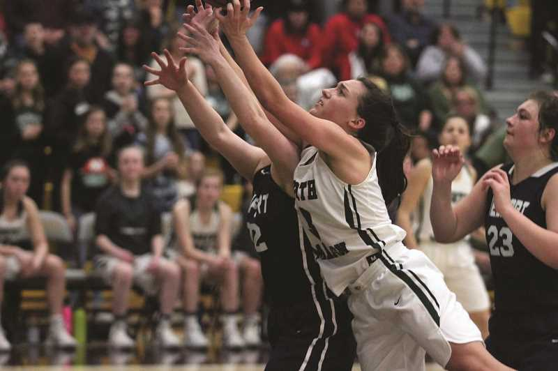 PMG PHOTO: PHIL HAWKINS - North Marion sophomore Mya Hammack fights for a rebound in the Huskies' 50-33 loss to Newport on Thursday.