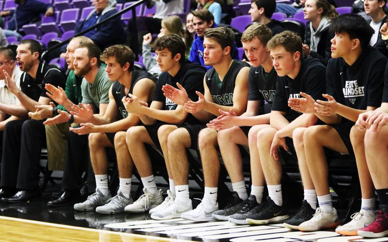PMG PHOTO: DAN BROOD - Players on the Tigard bench watch the action during the Tigers' state tournament game with Grant.