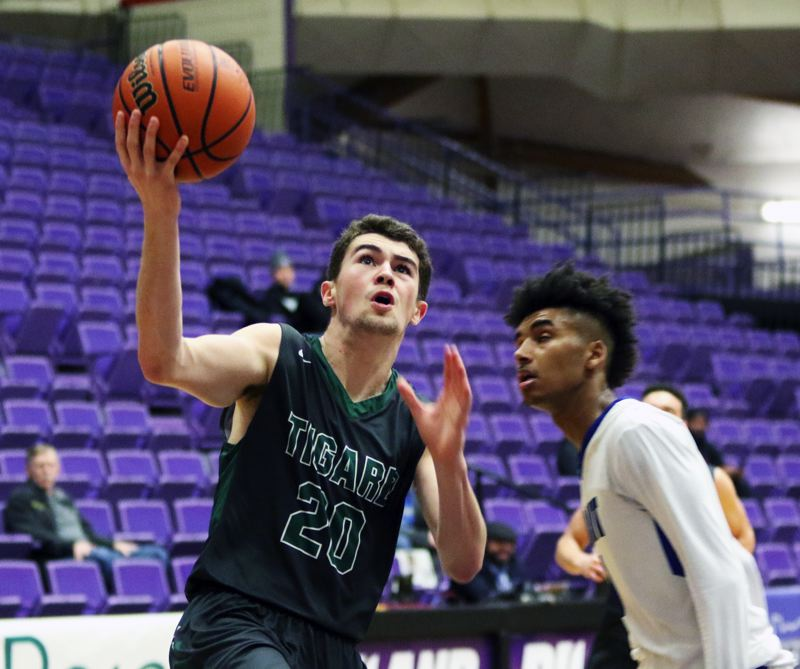 PMG PHOTO: DAN BROOD - Tigard High School senior Luke Ness (left) looks to go up to the basket during the Tigers' state tournament game against Grant.
