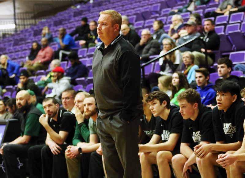 PMG PHOTO: DAN BROOD - Tigard High School head coach Shawn Alderman watches the action during the Tigers' state tournament game with Grant on Thursday.