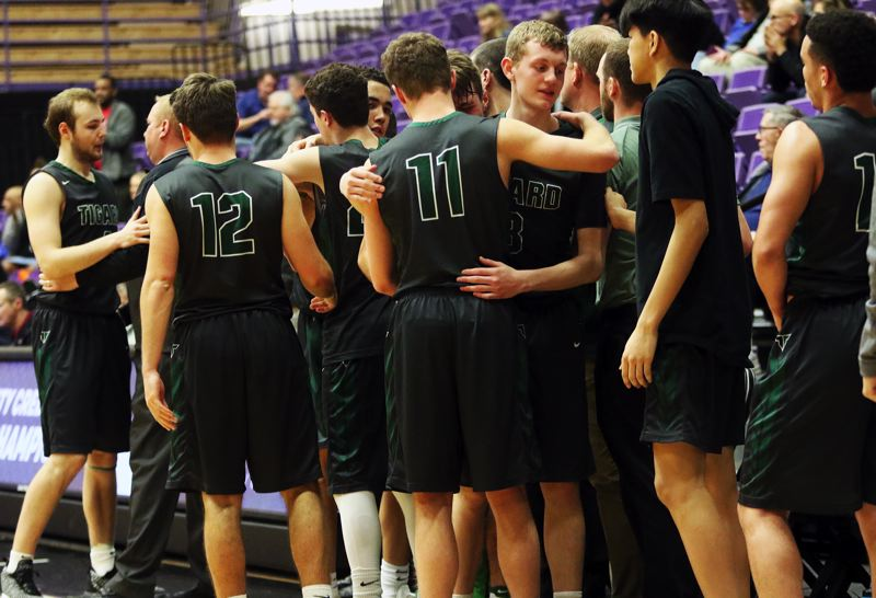 PMG PHOTO: DAN BROOD - Tigard players gather together toward the end of the team's state tournament game with Grant on Thursday.