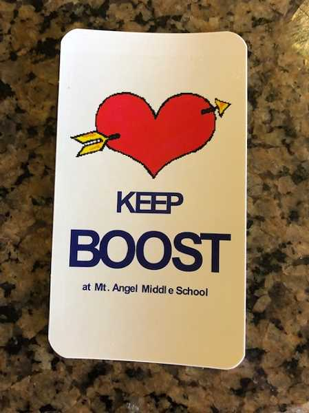 COURTESY OF TONI RUEF - Sticker worn by attendees at a Mount Angel School Board meeting show support of sixth-grade teacher and robotics coach Stacy Boost.