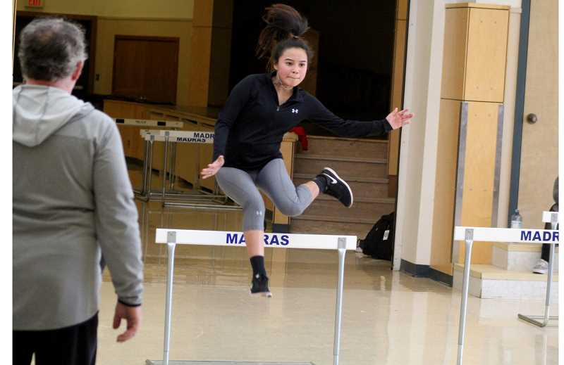 STEELE HAUGEN - Patty Speakthunder practices her hurdle events inside the cafeteria.