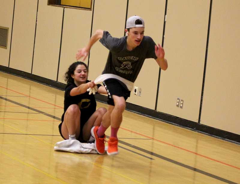STEELE HAUGEN - Luke Spinelli is being pulled by Irma Retano during an idoor practice before the season.