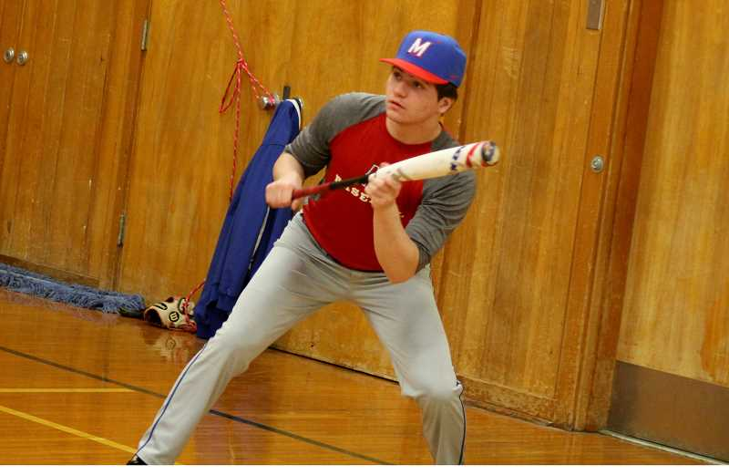 STEELE HAUGEN - Junior Liam White practices his bunting form during indoor practice before the season starts.