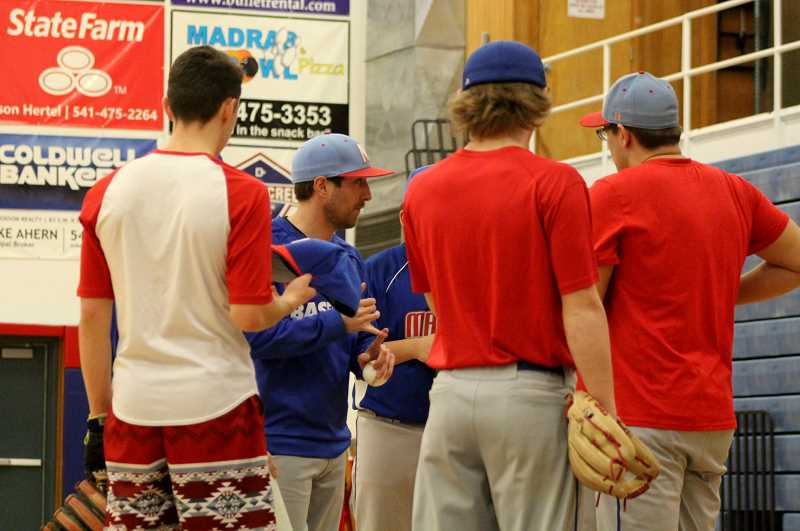 STEELE HAUGEN - Head Madras baseball coach Sam McCormick intructs a baseball team with only one senior.