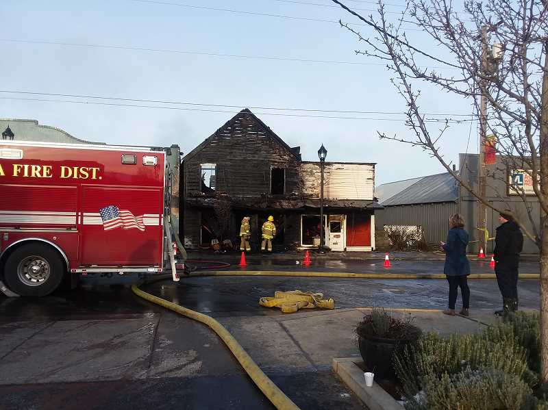 SANDY STOREY - What remained of the boutique building the day after the fire on Feb. 6.