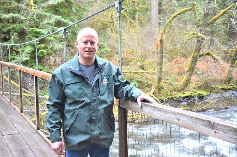 PMG PHOTO: EMILY LINDSTRAND - Clackamas County Park Ranger Victor Harshman cites Eagle Fern Park as his favorite location because of the old growth forest. Harshman has worked as a ranger since 1992.