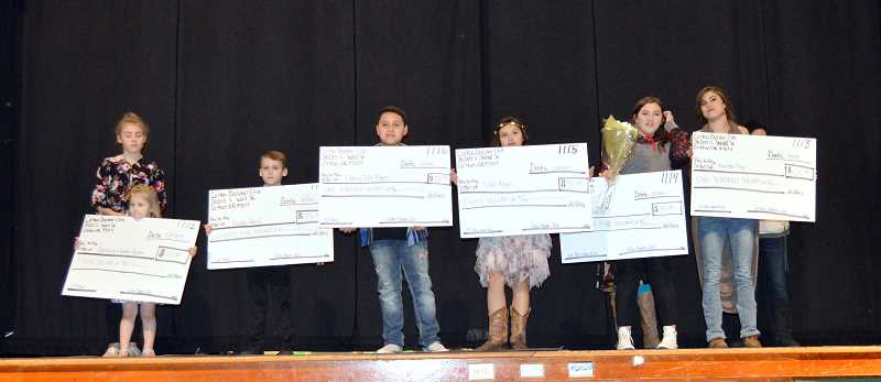 CINDY FAMA - The Stars on Stage winners are, from left to right: Anastaysja Pewitt and Avalyn Jackson (Arizona had fallen asleep), Reiden Ancell, Eddie Rogers, Della Rogers, Dahlia Lee Kierst and Keirsten Frye.
