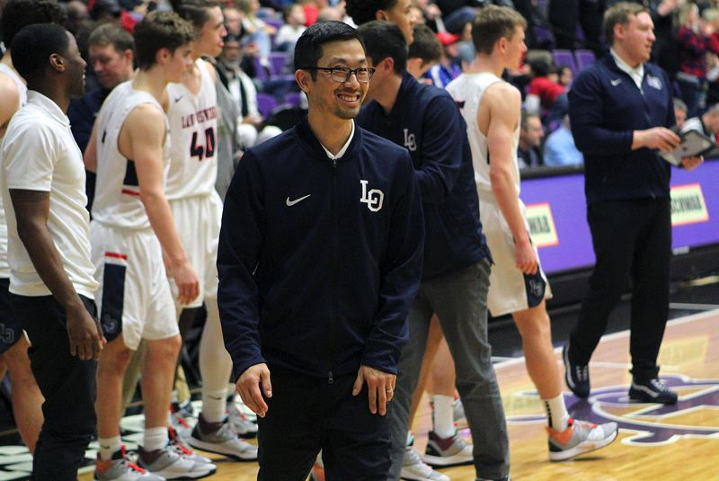 PMG PHOPTO: MILES VANCE - Lake Oswego boys basketball coach Marshall Cho had good reason to smile on Saturday after his Lakers beat South Salem to finish third in state. Earlier, Cho was named Three Rivers League Coach of the Year.