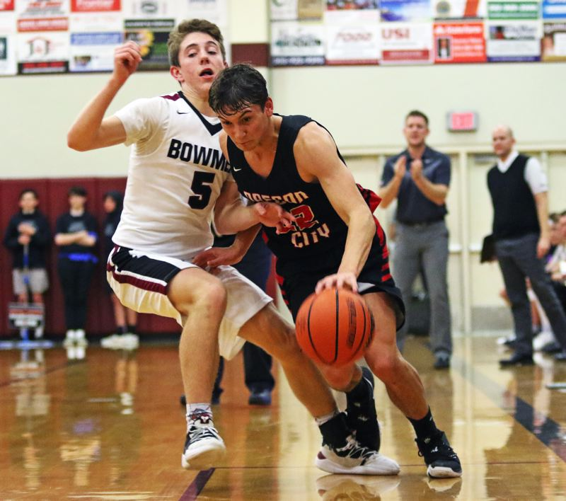 PMG PHOTO: DAN BROOD - Sherwood High School sophomore guard Asher Krauel (left) was named the Pacific Conference Defensive Player of the Year.