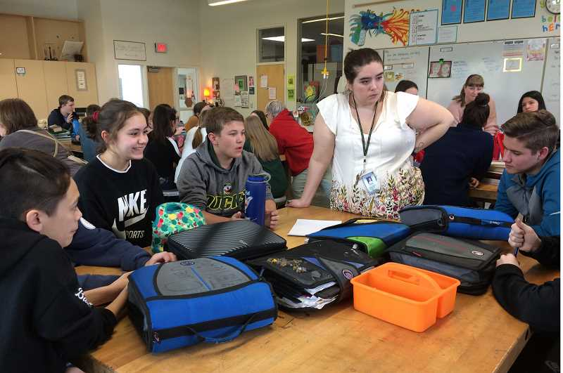 CAROL ROSEN - A group of youth respond to questions from teacher Amanda Graber during a recent youth summit information-gathering event.