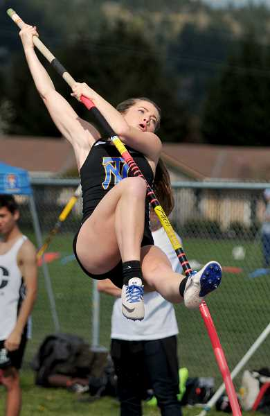 GRAPHIC FILE PHOTO - Polevaulter London Russell and the Newberg girls track team is expected to make significant strides after moving into the Pacific Conference.