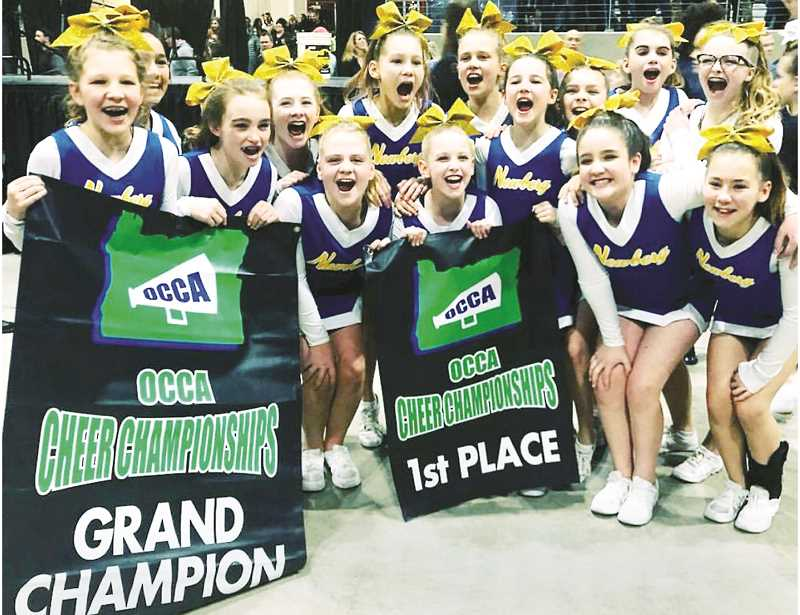 SUMBITTED PHOTO - The Newberg Youth Cheer junior high team was the grand champion at state, scoring more points than any team in any classification.